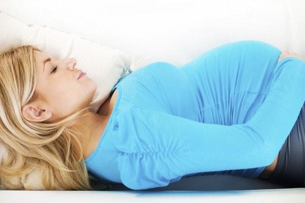 Pregnant blonde women sleeping.